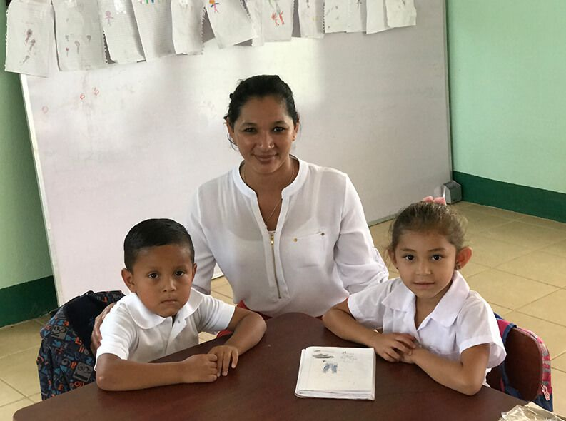 Two preschool students and their teacher smile at the camera. They attend the Bartolome de las Casas preschool in Matagalpa, Nicaragua. Credit: GPE/Carolina Valenzuela
